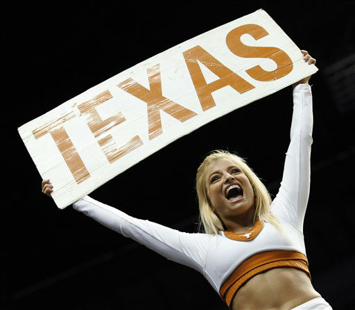 A Texas cheerleader performs in the first half of a second-round NCAA college basketball tournament game against Cincinnati on Friday, March 16, 2012, in Nashville, Tenn. &#40; <span class=meta>(AP Photo&#47; Donn Jones)</span>