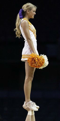 "<div class=""meta image-caption""><div class=""origin-logo origin-image ""><span></span></div><span class=""caption-text"">A Tennessee cheerleader performs during the second half of an NCAA tournament first-round women's college basketball game against UT Martin in Rosemont, Ill., Saturday, March 17, 2012. Tennessee won 72-49.  (AP Photo/ Nam Y. Huh)</span></div>"