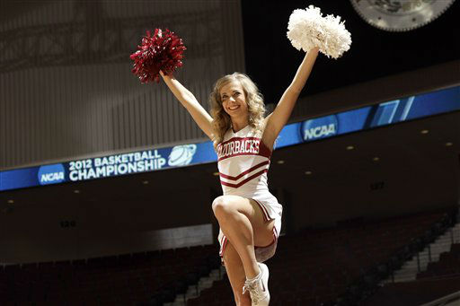 "<div class=""meta ""><span class=""caption-text "">Arkansas cheerleader during the first half of an NCAA tournament first-round college basketball game Saturday, March 17, 2012, in College Station, Texas.  (AP Photo/ David J. Phillip)</span></div>"