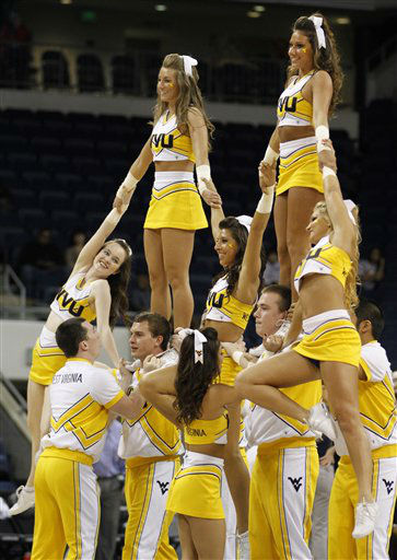 West Virginia cheerleaders cheer their team during the first half of the first round NCAA basketball game in Norfolk, Va., Saturday, March 17, 2012.   <span class=meta>(AP Photo&#47; Steve Helber)</span>