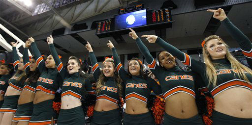 Miami cheerleaders motion to players after the team won in an NCAA tournament first-round women&#39;s college basketball game against Idaho State on Saturday, March 17, 2012, in Spokane, Wash. Miami won 70-41.  <span class=meta>(AP Photo&#47; Elaine Thompson)</span>