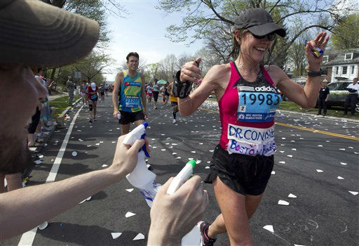"<div class=""meta ""><span class=""caption-text "">NO. 5: NEWTON, MA -- Marathon runner reacts as she's sprayed with mist as she reaches the top of Heartbreak Hill, in Newton, Mass., during the Boston Marathon. (AP Photo/ Steven Senne)</span></div>"