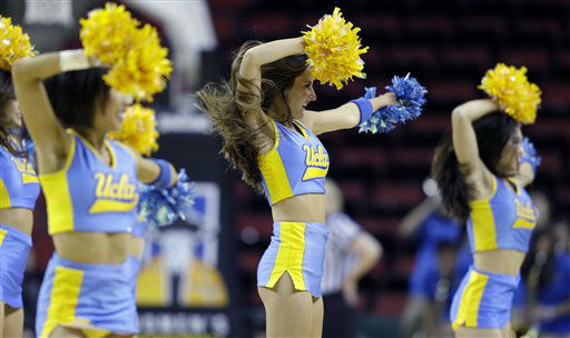 UCLA cheerleaders perform during an NCAA college basketball game against Utah in the Pac-12 Conference tournament, Friday, March 8, 2013, in Seattle. &#40;AP Photo&#47;Ted S. Warren&#41; <span class=meta>(AP Photo&#47; Ted S. Warren)</span>