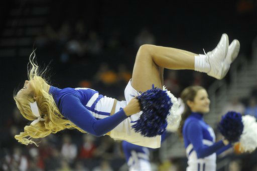 A Kentucky  cheerleader performs during the first half of a NCAA college basketball game against Tennessee in the Southeastern Conference tournament, Saturday, March 9, 2013, in Duluth, Ga.  &#40;AP Photo&#47;John Amis&#41; <span class=meta>(AP Photo&#47; John Amis)</span>