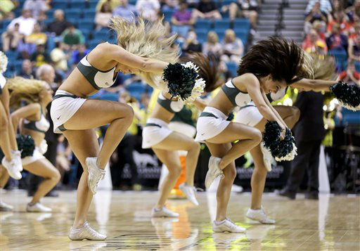 Oregon cheerleaders perform during a timeout during a Pac-12 tournament NCAA college basketball game against Washington, Thursday, March 14, 2013, in Las Vegas. &#40;AP Photo&#47;Julie Jacobson&#41;  <span class=meta>(AP Photo&#47; Julie Jacobson)</span>