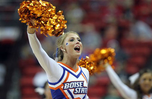 A Boise State's cheerleader performs during the first half of a Mountain West Conference tournament NCAA college basketball game against San Diego State on Wednesday, March 13, 2013, in Las Vegas. (AP Photo/Isaac Brekken)