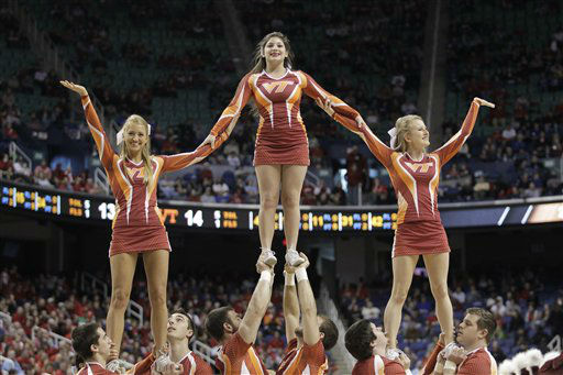 "<div class=""meta image-caption""><div class=""origin-logo origin-image ""><span></span></div><span class=""caption-text"">Virginia Tech cheerleaders perform during the first half of an NCAA college basketball game against North Carolina State at the Atlantic Coast Conference tournament in Greensboro, N.C., Thursday, March 14, 2013. (AP Photo/Bob Leverone) (AP Photo/ Bob Leverone)</span></div>"
