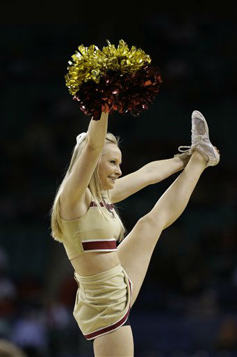 A Boston College cheerleader performs during the first half of an NCAA college basketball game against Georgia Tech  at the Atlantic Coast Conference tournament in Greensboro, N.C., Thursday, March 14, 2013. &#40;AP Photo&#47;Gerry Broome&#41; <span class=meta>(AP Photo&#47; Gerry Broome)</span>
