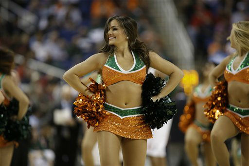 A Miami cheerleader performs during the first half of an NCAA college basketball game against Boston College at the Atlantic Coast Conference tournament in Greensboro, N.C., Friday, March 15, 2013. &#40;AP Photo&#47;Bob Leverone&#41; <span class=meta>(AP Photo&#47; Bob Leverone)</span>