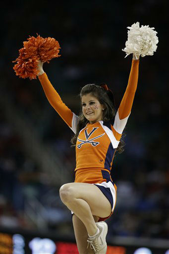 A Virginia cheerleader performs during the first half of an NCAA college basketball game against North Carolina State at the Atlantic Coast Conference tournament in Greensboro, N.C., Friday, March 15, 2013. &#40;AP Photo&#47;Bob Leverone&#41; <span class=meta>(AP Photo&#47; Bob Leverone)</span>