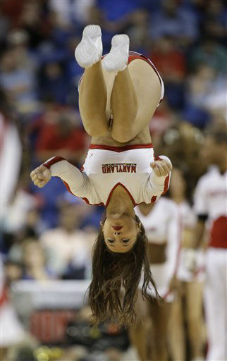 A Maryland cheerleader performs during the second half of an NCAA college basketball game against North Carolina in the semifinals of the Atlantic Coast Conference tournament in Greensboro, N.C., Saturday, March 16, 2013. &#40;AP Photo&#47;Bob Leverone&#41; <span class=meta>(AP Photo&#47; Bob Leverone)</span>