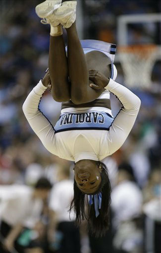 A North Carolina cheerleader performs during the first half of an NCAA college basketball game in the championship of the Atlantic Coast Conference tournament in Greensboro, N.C., Sunday, March 17, 2013. &#40;AP Photo&#47;Bob Leverone&#41; <span class=meta>(AP Photo&#47; Bob Leverone)</span>