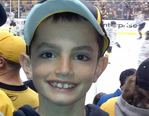 "<div class=""meta image-caption""><div class=""origin-logo origin-image ""><span></span></div><span class=""caption-text"">This undated photo provided by Bill Richard shows his son, Martin Richard, in Boston. Martin Richard, 8, was among the at least three people killed in the explosions at the finish line of the Boston Marathon Monday, April 15, 2013. (AP Photo/Bill Richard) (AP Photo/ KXS**NY** AJ**NY**)</span></div>"