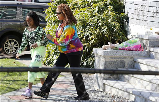 "<div class=""meta ""><span class=""caption-text "">Jacqueline Myers and her daughter Amira, 10, depart after leaving flowers on the doorstep of the Richard house in the Dorchester neighborhood of Boston,Tuesday, April 16, 2013.  Martin Richard, 8, was killed in Mondays bombing at the finish line of the Boston Marathon.  (AP Photo/ Michael Dwyer)</span></div>"