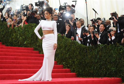 "<div class=""meta image-caption""><div class=""origin-logo origin-image ""><span></span></div><span class=""caption-text"">Singer Rihanna arrives at The Metropolitan Museum of Art's Costume Institute benefit gala celebrating ""Charles James: Beyond Fashion"" on Monday, May 5, 2014, in New York. (Photo/Evan Agostini)</span></div>"