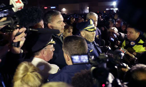 "<div class=""meta ""><span class=""caption-text "">Officials brief the media on a standoff in Watertown, Mass., Friday, April 19, 2013. Authorities say one of two suspects in the Boston Marathon bombing is dead and a massive manhunt is underway for another in the Boston suburb of Watertown early Friday morning April 19, 2013.    (AP Photo/ Julio Cortez)</span></div>"