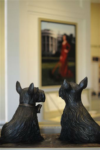 In this photo taken April 16, 2013, statues of Barney, left, and Miss Beazley, the beloved Scottish Terriers of president George W. Bush and Laura Bush, are seen in the museum area at the George W. Bush Presidential Library and Museum in Dallas.  The museum uses everything from news clips to interactive screens to artifacts to tell the story of Bush?s eight years in office. The George W. Bush Presidential Center, which includes the library and museum along with 43rd president?s policy institute, will be dedicated Thursday on the campus of Southern Methodist University in Dallas. &#40;AP Photo&#47;Benny Snyder&#41; <span class=meta>(AP Photo&#47; Benny Snyder)</span>