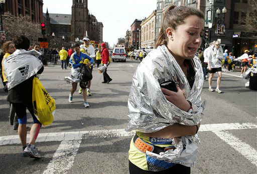 An unidentified Boston Marathon runner leaves the course crying near Copley Square following an explosion in Boston Monday, April 15, 2013.   <span class=meta>(AP Photo&#47; Winslow Townson)</span>