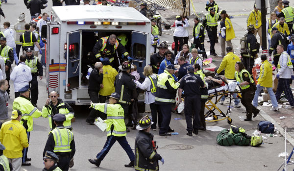 Medical workers aid injured people at the finish line of the 2013 Boston Marathon  in Boston, Monday, April 15, 2013.   Two bombs exploded near the finish line of the Boston Marathon on Monday, killing at least two people and injuring dozens of others   <span class=meta>(AP Photo&#47; Charles Krupa)</span>