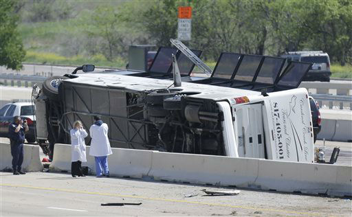 A charter bus rests on it&#39;s side after crashing on the President George Bush Turnpike Thursday, April 11, 2013, in Irving, Texas. The chartered bus overturned on the busy highway near Dallas killing at least two people and injuring several others, authorities said. &#40;AP Photo&#47;LM Otero&#41; <span class=meta>(AP Photo&#47; LM Otero)</span>