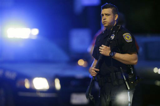 A police officer stands guard at the scene as the search for suspect in the Boston Marathon bombings continues , Friday, April 19, 2013, in Watertown, Mass. Gunfire erupted Friday night amid the manhunt for the surviving suspect in the Boston Marathon bombing, and police in armored vehicles and tactical gear rushed into the Watertown neighborhood in a possible break in the case.   <span class=meta>(AP Photo&#47; Matt Rourke)</span>