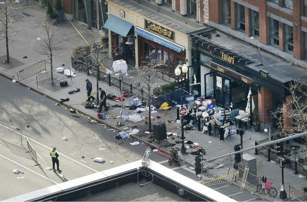 "<div class=""meta ""><span class=""caption-text "">One of the blast sites on Boylston Street near the finish line of the 2013 Boston Marathon is investigated and guarded by police in the wake of two blasts in Boston Monday, April 15, 2013.  (AP Photo/ Elise Amendola)</span></div>"