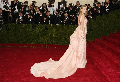 "<div class=""meta image-caption""><div class=""origin-logo origin-image ""><span></span></div><span class=""caption-text"">Taylor Swift attends The Metropolitan Museum of Art's Costume Institute benefit gala celebrating ""Charles James: Beyond Fashion"" on Monday, May 5, 2014, in New York.  (Photo/Charles Sykes)</span></div>"