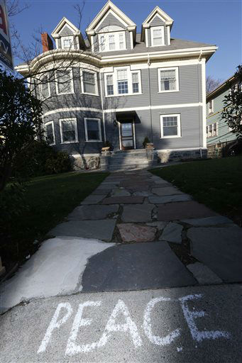 Peace is written on the sidewalk in front of the Richard house in the Dorchester neighborhood of Boston, Tuesday, April 16, 2013.  Martin Richard, 8,  was killed in Monday&#39;s bombing at the finish line of the Boston Marathon. &#40;AP Photo&#47;Michael Dwyer&#41; <span class=meta>(AP Photo&#47; Michael Dwyer)</span>
