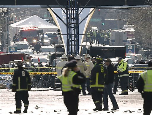 "<div class=""meta ""><span class=""caption-text "">Emergency responders gather around the finish line of the Boston Marathon following an explosion in Boston Monday, April 15, 2013. (AP Photo/Winslow Townson) (AP Photo/ Winslow Townson)</span></div>"