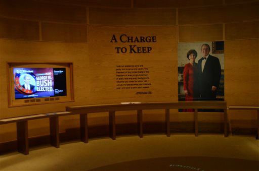 In this photo taken April 16, 2013, a portion an exhibit is shown in the museum area at the George W. Bush Presidential Library and Museum in Dallas. The museum uses everything from news clips to interactive screens to artifacts to tell the story of Bush?s eight years in office. The George W. Bush Presidential Center, which includes the library and museum along with 43rd president?s policy institute, will be dedicated Thursday on the campus of Southern Methodist University in Dallas. &#40;AP Photo&#47;Benny Snyder&#41; <span class=meta>(AP Photo&#47; Benny Snyder)</span>