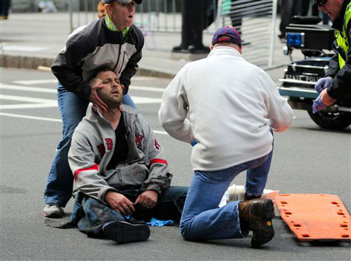 In this photo provided by The Daily Free Press and Kenshin Okubo, people assist an injured after an explosion at the 2013 Boston Marathon in Boston, Monday, April 15, 2013. Two explosions shattered the euphoria of the Boston Marathon finish line on Monday, sending authorities out on the course to carry off the injured while the stragglers were rerouted away from the smoking site of the blasts. &#40;AP Photo&#47;The Daily Free Press, Kenshin Okubo&#41; MANDATORY CREDIT <span class=meta>(AP Photo&#47; Kenshin Okubo)</span>