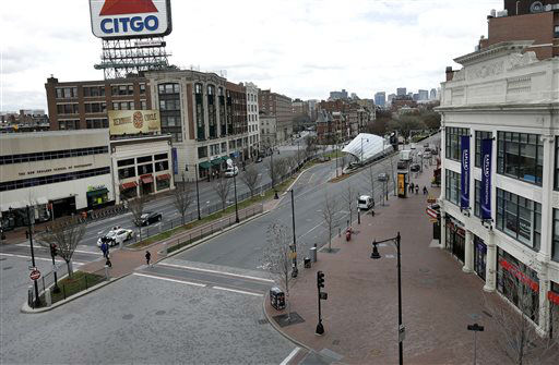 "<div class=""meta image-caption""><div class=""origin-logo origin-image ""><span></span></div><span class=""caption-text"">The usually busy Kenmore Square in Boston is virtually deserted at lunchtime Friday, April 19, 2013, during a call for ""shelter-in-place"" for Boston and some area communities. Two suspects in the Boston Marathon bombing killed an MIT police officer, injured a transit officer in a firefight and threw explosive devices at police during their getaway attempt in a long night of violence that left one of them dead and another still at large Friday, authorities said as the manhunt intensified for a young man described as a dangerous terrorist.   (AP Photo/ Elise Amendola)</span></div>"