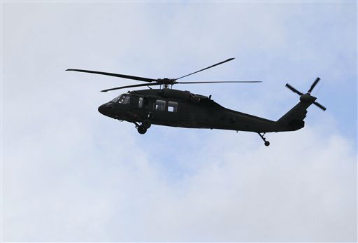 A helicopter hovers over Watertown, Mass., Friday, April 19, 2013, as officials search for an individual believed to be responsible for the Boston Marathon explosions. Dozens of officers and National Guard members are in Watertown, where gunfire and explosions were heard early Friday morning.  <span class=meta>(AP Photo&#47; Julio Cortez)</span>