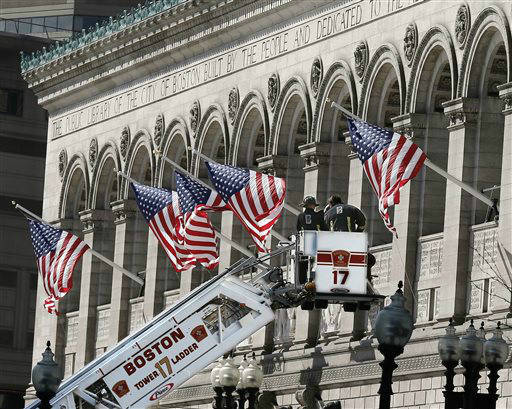 "<div class=""meta ""><span class=""caption-text "">Responders search the area around the Boston Public Library near the finish line of the Boston Marathon with a ladder truck in Boston Tuesday, April 16, 2013.  Two bombs blew up seconds apart Monday at the finish line of one of the world's most storied races, tearing off limbs and leaving the streets spattered with blood and strewn with broken glass. At least three people were killed, including an 8-year-old boy, and more than 170 were wounded. (AP Photo/Winslow Townson) (AP Photo/ Winslow Townson)</span></div>"