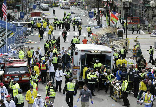 Medical workers aid injured people at the finish line of the 2013 Boston Marathon following an explosion in Boston, Monday, April 15, 2013.  Two explosions shattered the euphoria of the Boston Marathon finish line on Monday, sending authorities out on the course to carry off the injured while the stragglers were rerouted away from the smoking site of the blasts. &#40;AP Photo&#47;Charles Krupa&#41; <span class=meta>(AP Photo&#47; Charles Krupa)</span>