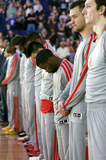 Houston Rockets players observe a moment of silence for the victims of the Boston Marathon explosions before an NBA basketball game against the Phoenix Suns, Monday, April 15, 2013 in Phoenix.   <span class=meta>(AP Photo&#47; Matt York)</span>