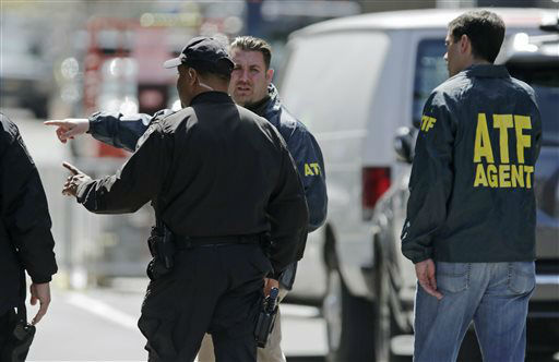 A Boston Police officer, front left, talks with two ATF agents at the scene of Monday&#39;s Boston Marathon explosions, which killed three and injured more than 140, in Boston, Tuesday, April 16, 2013. The bombs that blew up seconds apart near the finish line left the streets spattered with blood and glass, and gaping questions of who chose to attack at the Boston Marathon and why. &#40;AP Photo&#47;Charles Krupa&#41; <span class=meta>(AP Photo&#47; Charles Krupa)</span>