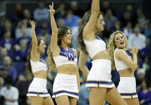 Washington cheerleaders perform during an NCAA college basketball game against Washington State, Sunday, March 3, 2013, in Seattle. &#40;AP Photo&#47;Ted S. Warren&#41; <span class=meta>(AP Photo&#47; Ted S. Warren)</span>