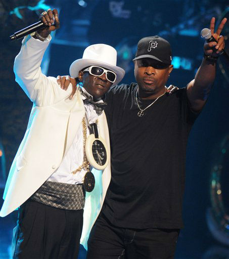 FILE - This Sept. 23, 2009 file photo shows Rappers Flavor Flav, left, and Chuck D of the music group Public Enemy, perform at the 2009 VH1 Hip Hop Honors at the Brooklyn Academy of Music, in New York. The eclectic group of rockers Rush and Heart, rappers Public Enemy, songwriter Randy Newman, &#34;Queen of Disco&#34; Donna Summer and bluesman Albert King will be inducted into the Rock and Roll Hall of Fame next April in Los Angeles. The inductees were announced Tuesday by 2012 inductee Flea of The Red Hot Chili Peppers at a news conference in Los Angeles. &#40;AP Photo&#47;Peter Kramer, file&#41; <span class=meta>(AP Photo&#47; Peter Kramer)</span>
