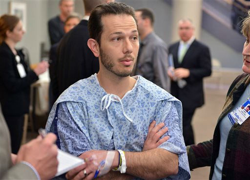 Nicholas Yanni, 32, of Boston, speaks to reporters at Tufts Medical Center in Boston, Tuesday, April 16, 2013. Yanni, and his wife, Lee Ann Yanni, 31, were among the 14 patients injured in the bombing at the finish of the Boston Marathon who were treated at Tufts. &#40;AP Photo&#47;Josh Reynolds&#41; <span class=meta>(AP Photo&#47; JOSH REYNOLDS)</span>