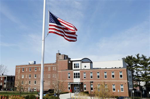 "<div class=""meta image-caption""><div class=""origin-logo origin-image ""><span></span></div><span class=""caption-text"">The flag flies at half staff in front of the Neighborhood House Charter School in the Dorchester neighborhood of Boston, Tuesday, April 16, 2013. Boston Marathon bombing victim, 8-year old Martin Richard attended the school. (AP Photo/Michael Dwyer) (AP Photo/ Michael Dwyer)</span></div>"