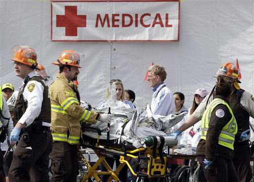 Medical personnel work outside the medical tent in the aftermath of two blasts which exploded near the finish line of the Boston Marathon in Boston, Monday, April 15, 2013. &#40;AP Photo&#47;Elise Amendola&#41;  <span class=meta>(AP Photo&#47; Elise Amendola)</span>