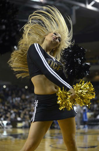 A Central Florida cheerleader performs during the first half of an NCAA college basketball game against Memphis in Orlando, Fla., Saturday, March 2, 2013. Memphis won 76-67.&#40;AP Photo&#47;Phelan M. Ebenhack&#41;  <span class=meta>(AP Photo&#47; Phelan M. Ebenhack)</span>