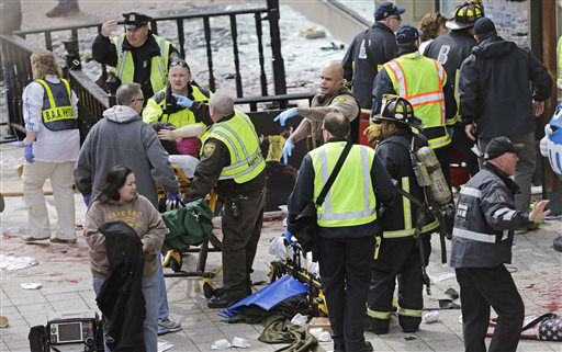 Medical workers aid injured people at the finish line of the 2013 Boston Marathon following explosions in Boston, Monday, April 15, 2013. Two explosions shattered the euphoria of the Boston Marathon finish line on Monday, sending authorities out on the course to carry off the injured while the stragglers were rerouted away from the smoking site of the blasts. &#40;AP Photo&#47;Charles Krupa&#41; <span class=meta>(AP Photo&#47; Charles Krupa)</span>