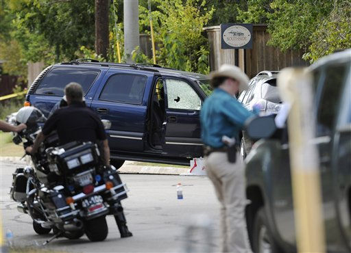 Law enforcement officials investigate an area where police say a gunman was being served an eviction notice when he opened fire from inside a home near Texas?A&#38;M and killed a law enforcement officer  Monday, Aug. 13, 2012, in College Station, Texas. Three people, including the gunman, were killed in the shootout. &#40;AP Photo&#47;Pat Sullivan&#41; <span class=meta>(AP Photo&#47; Pat Sullivan)</span>