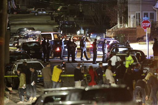 "<div class=""meta image-caption""><div class=""origin-logo origin-image ""><span></span></div><span class=""caption-text"">Police work a crime scene Friday, April 19, 2013, in Watertown, Mass. A tense night of police activity that left a university officer dead on campus just days after the Boston Marathon bombings and amid a hunt for two suspects caused officers to converge on a neighborhood outside Boston, where residents heard gunfire and explosions.  (AP Photo/ Matt Rourke)</span></div>"