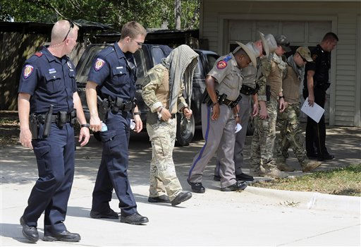 Law enforcement officials conduct a grid search of an area where police say a gunman was being served an eviction notice when he opened fire from inside a home near Texas?A&#38;M and killed a law enforcement officer  Monday, Aug. 13, 2012, in College Station, Texas. Three people, including the gunman, were killed in the shootout. &#40;AP Photo&#47;Pat Sullivan&#41; <span class=meta>(AP Photo&#47; Pat Sullivan)</span>