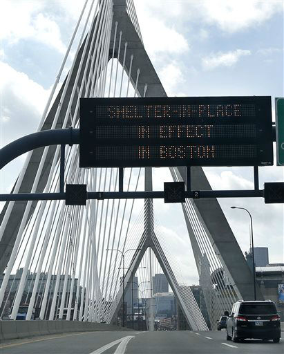 A message calling for citizens of Boston to &#34;Shelter in Place&#34; flashes on a sign on I-93 near the Zakim Bridge in Boston Friday, April 19, 2013. The Boston area was all but paralyzed as a manhunt continued for Dzhokhar Tsarnaev, one of the two suspects in the Boston Marathon bombing who authorities say killed an MIT police officer and hurled explosives at police in a car chase and gun battle overnight that left his brother, Tamerian Tsarnaev, dead.  <span class=meta>(AP Photo&#47; Elise Amendola)</span>
