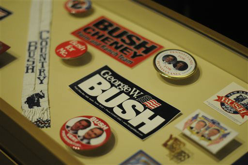 In this photo taken April 16, 2013, various campaign memorabilia is shown in the museum area at the George W. Bush Presidential Library and Museum in Dallas.  The museum uses everything from news clips to interactive screens to artifacts to tell the story of Bush?s eight years in office.  The George W. Bush Presidential Center, which includes the library and museum along with 43rd president?s policy institute, will be dedicated Thursday on the campus of Southern Methodist University in Dallas. &#40;AP Photo&#47;Benny Snyder&#41; <span class=meta>(AP Photo&#47; Benny Snyder)</span>