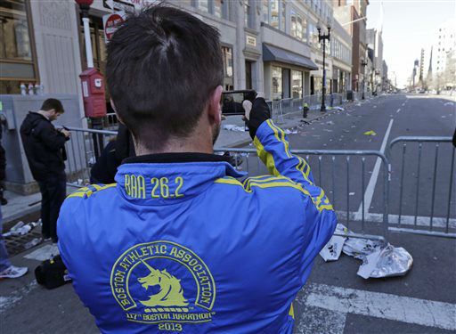 Paul McRae, a native of New Zealand now living in Jacksonville, takes a photograph of an empty Boylston Avenue near the Boston Marathon finish line, in Boston, Tuesday, April 16, 2013.  Three people and more than 140 were injured when bombs exploded seconds apart close to the finish line on Monday. McRae finished the race before the explosions.    <span class=meta>(AP Photo&#47; Charles Krupa)</span>